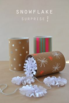 DIY: mini garland in a mini shipping tube - what a great idea for storing ornaments of paper, or even fragile glass