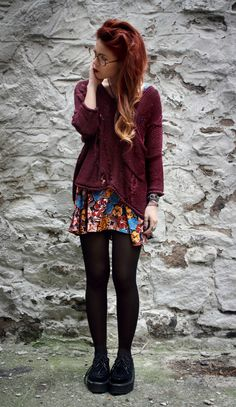 Burgundy red sweater and black pantyhose