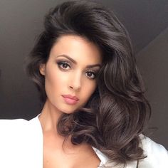 Need this look? Clip in extensions are a great way to add volume and body.  Check out our clip in extensions at Hair Factory: https://www.hairfactory.com/clip-in-hair.html