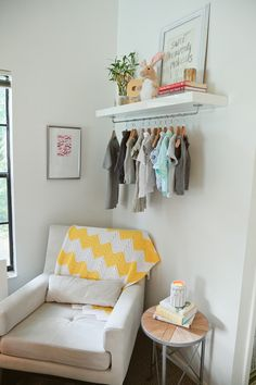 DIY Nursery Wardrobe Shelf. Two reasons I like the idea of having some go to baby clothes on show: 1. Easy access to the most frequently worn clothes. 2. The clothes could add some color and texture to the room
