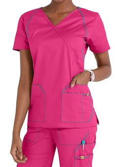 CROSSOVER STYLE A trio of stylized front pockets are a nice touch on this WonderWink crossover V-neck scrub top. Other design details include decorative and functional seaming, from back and shoulder yokes and princess seams to sleeve seams with a built-in bungee loop. Comfortable 7 Flext fabric makes this top a pleasure to wear. WonderWink 7 Flex Crossover Scrub Tops V-neck 3 lower stylized pockets (1 with nylon logo slider) Mock wrap Front princess seams Back and sho... Scrubs Outfit, Scrubs Uniform, Scrubs Pattern, Lab Coats, Medical Scrubs, Scrub Tops, Blouse Styles, Comfortable Fashion, V Neck Tops