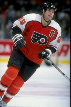 Eric Lindros - Oh wow, I had my walls plastered with him when I was 16/17 :)  ORANGE & BLACK BABY!!!!