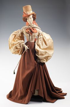 """1830 Doll""  Madeleine de Rauch   Designer: Claude Designer: Roger Fare (French) Date: 1949 Culture: French Medium: metal, plaster, hair, wool, silk, straw, leather Dimensions: 31 x 16 in. (78.7 x 40.6 cm) Credit Line: Brooklyn Museum Costume Collection at The Metropolitan Museum of Art, Gift of the Brooklyn Museum, 2009; Gift of Syndicat de la Couture de Paris, 1949"