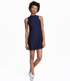 Dark blue. Short, sleeveless A-line dress in crêped jersey with a small stand-up collar.