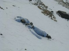 Dead Bodies on Mount Everest - many perfectly preserved bodies lie on top of Mount Everest - Some die from falls leaving their bodies in a location where they can be seen but not recovered.  Bodies that are located on small ledges are often rolled off to hide them from view of other climbers only to be later buried by falling snow.