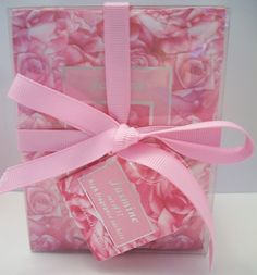 Brand new boxed set of 12 high fragrance Jasmine sachets. Packaged in a clear plastic box, wrapped with a pink bow, a faceted crystal shaped bead is attached to the bow. #alexamigos
