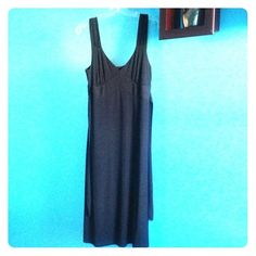 Little Black Dress Only worn once! Soft, flowy material. Knee-length...have it altered above the knee for extra appeal!!!!! Side ties go around the back. Triangle accented shap in the bust area! Ann Taylor Dresses