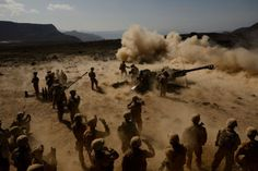 U.S. Marines with the 13th Marine Expeditionary Unit (MEU) Battalion Landing Team 1/4 fire the M777 Howitzer during a battery defense battle drill at Arta Range, Nov. 3, 2013. The 13th MEU is deployed with the Boxer Amphibious Ready Group as a theater reserve and crisis response force throughout the U.S. 5th Fleet area of responsibility. (U.S. Air Force photo by Staff Sgt. Staci Miller/RELEASED)