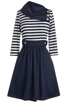 The combo dress is featuring striped top, oblique neckline. It flaunts a slight A-like silhouette.