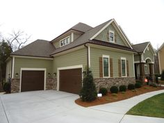Architecture Green Siding House Exterior Paint Colors For With Brown Roof Exterior House Colors Green Exterior Paint Colors For House, Paint Colors For Home, Exterior Colors, Paint Colours, Outdoor House Colors, Exterior Design, Brown Garage Door, Garage Doors, Garage House