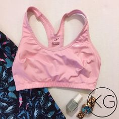 "Nike Pro Dri-Fit Compression Bra in Light Pink In great pre-owned condition! •Women's size S •82% Polyester, 18% Rayon •11"" across elastic band no trades nor lowball offers Thank you for shopping in my closet! Nike Intimates & Sleepwear Bras"