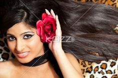 top view of a attractive female with a rose in her hair. - Top view of a attractive female with a rose in her hair looking at camera, Model: Stephanie Reddy