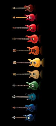 Colors Rock - Variety of electric guitars arranged in rainbow bright crayola coloring.