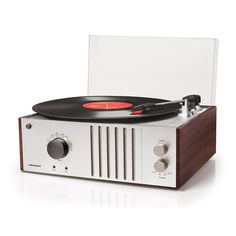 Add an element of retro chic in your home with the Crosley Radio Player Turntable. It also features an analog AM/FM radio, dynamic full-range integrated speaker and a portable audio input for connecting players and other external devices. Crosley Record Player, Record Players, Sam's Club, Radios, Walmart, Cabinet Styles, Retro Chic, Dot And Bo, Mid Century Design