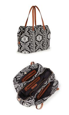 Oversized woven tote bag in black & white tribal print with shoulder straps, zipper closure and three inside sections