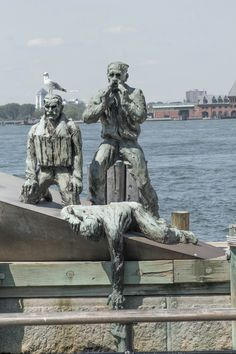 American Merchant Mariners Memorial Location: Breakwater extension,     Sculptor: Marisol Escobar     Description: Three figures on boat, one figure is trying to grasp another figure that is in the water    Cast: 1991     Dedicated: October 8, 1991 Battery Park, Manhattan, NYC (08/24/2016)
