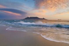 Wide angle landscape photo of a wave washing over a beach in sunset light with table mountain in the background. Beautiful Places To Visit, Beautiful Beaches, Cool Places To Visit, Places To Go, Landscape Photos, Landscape Photography, Nature Photography, Volunteer In Africa, Clifton Beach