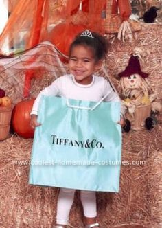 Homemade Little Blue Shopping Bag Costume: Everyone loves something in a little blue box (blue shopping bag in this case).  Milan and her Daddy love buying Mommy gifts at Tiffany's especially for