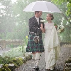 This bride and groom didn't let rain dampen their spirits! A beautiful and romantic rustic barn wedding in Ireland.