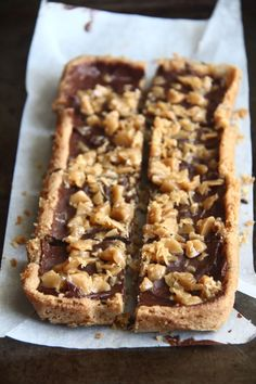 Caramel crunch bars - chocolate chip cookie bars covered in melted chocolate and topped with Heath bits.