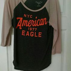 American Eagle Baseball Tee This T-shirt is super comfy to throw on and go out for lunch or running errands!  Listed as size large but fits a medium or small better!  Small cracking in the orange writing but still looks great!  Make an offer?? American Eagle Outfitters Tops Tees - Long Sleeve