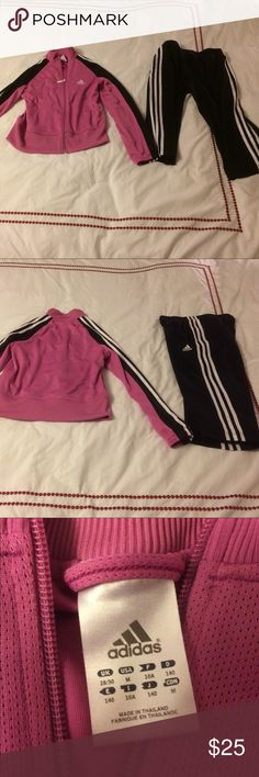 Adidas girls track sweat suit pink and black M Super cute girls medium pink and black track suit.   Every little girl needs this item in her wardrobe!  Worn a couple of times then grew out of it.  Excellent condition. Priced to sell. Adidas Matching Sets
