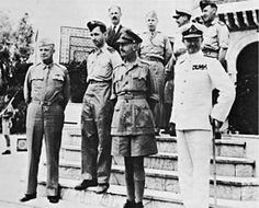 Allied leaders in the Sicilian campaign. General Eisenhower meets in North Africa with (foreground, left to right): Air Chief Marshal Sir Arthur Tedder, General Sir Harold R. L. G. Alexander, Admiral Sir Andrew B. Cunningham, and (top row): Mr. Harold Macmillan, Major General W. Bedell Smith, and unidentified British officers.