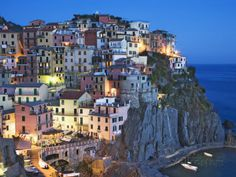 Dusk Falls on a Hillside Town Overlooking the Mediterranean Sea, Manarola, Cinque Terre, Italy Photographic Print by Dennis Flaherty at AllPosters.com