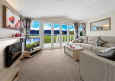 Illustrated with optional bi-fold doors. TV and DVD player not included. Wall art optional extra