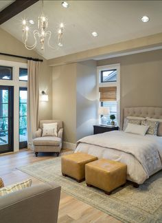 Stylish Family Home with Transitional Interiors The master bedroom features a custom upholstered bed, vaulted ceilings and a hanging chandelier. French doors open to the covered front porch with views of the valley. Bedding is from Restoration Hardware.