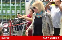 Yes, that crazy old bat Joan Rivers handcuffed herself to a shopping cart in COSTCO to promote her book. Now that's is commitment to a bit! Go Joan!