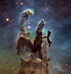The Pillars of Creation: This may be one of the most recognized Hubble images. It captured the multi-colored glow of the gas clouds, the tendrils of dark cosmic dust, and the famous rust-colored pillars as seen in visible light.