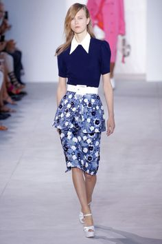 The optimism spilled over into the '40s-era silhouettes in bright tight florals worthy of Marimekko. There were peplum pencil skirts, peak-shouldered day dresses, golfy vests and bermudas and of course high-waisted bikinis—but all aspects of the jetset life must be covered.