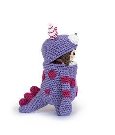 Little Ella in her monster suit, a design by Little Aqua Girl // 'Amigurumi Monsters' book // Dim the lights, bring out your flashlight and quickly check underneath your bed: this new book will reveal the most adorable amigurumi monsters!