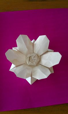 My attempt at David Martinez' six-petal origami field flower. I added some extra folds at the end to 'puff out' the petals. Video tutorial by Leyla Torres of Origami Spirit here: http://www.origamispirit.com/2014/08/six-petal-origami-flower/