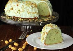 Homemade Pistachio Pudding Cake- no cake mix makes this pistachio pudding cake a dessert dream come true! Topped with Pistachio Buttercream Icing!