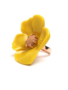 The de rigueur cocktail ring doesn't get more charming and playful than this. Instead of a faceted stone, it flaunts an oversized poppy flower, intricately sculpted and cast in deep, rich yellow.  DRESS: SOLD OUT. SHOP SIMILAR LOOKS