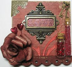 a small 3-d piece, using fab Tim Holtz and wendy vecchi products,chuffed with my 3-d rose and i love these little bottles!!!