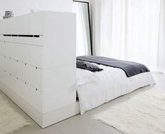 Magnificent bedroom storage - if you have the space, build a dressing area behind the bed that also serves as a headboard.
