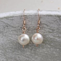 Rose gold and pearls are a match made in heaven, Jewellery Made by Me's simple pearl drop earrings are ideal for a classic look.