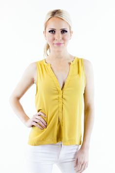 solid-colored V-neck sleeveless woven blouse with button closures in the front