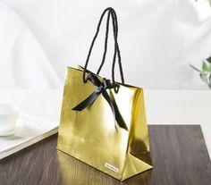 premium paper bag, luxury paper bag, glossy gold paper bag, black ribbon strap handles,