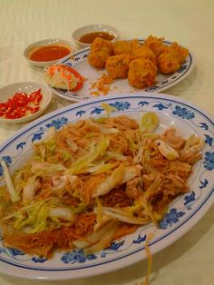 Singapore, Hokkien food. Cha Mew Sua and Hae Cho. Fried rice vermicelli with leek, cabbage, shrimp, squid, chicken gizzard, pork and fish slices. Deep-fried shrimp, pork, water chestnut rolls.