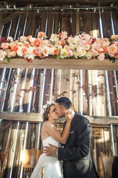 how gorgeous are those florals and hanging butterflies? Such a great backdrop!