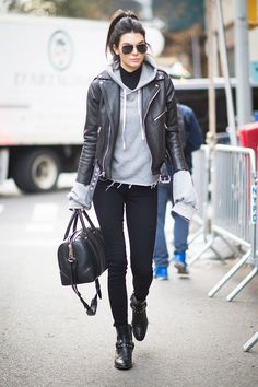 On Jenner:Unravel Oversized Cashmere Hoodie($350); Laer Classic Moto Jacket($800); Paige Denim Transcend Margot Ultra Skinny Jeans($179); Saint Laurent boots; Givenchy...