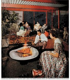 """Los Angeles architect Quincy Jones grills some steaks for his guests inside his home -- """"Life Magazine"""" photoshoot, 1955."""