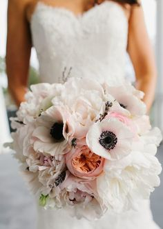 15 Beautiful Wedding Bouquets | PreOwnedWeddingDresses.com Anemones, dahlias, sweatpea, lavender, astilbe, ranunculus.