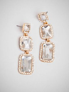 Why settle for one when you can have three gorgeously oversized rectangular gems, all set amongst an array of pave crystals for an extra shot of glam