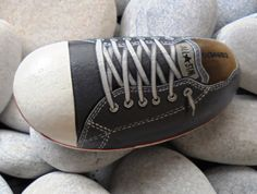 Hand painted stone grey ALL STAR shoe!  A great handmade painted stone from me!    Is painted on a smooth sea stone which i have collected from a