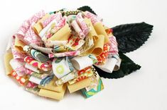 fabric/ribbon flower.  http://rebeccasower.typepad.com/rs_out_of_hand/2010/02/the-feel-of-flowers.html